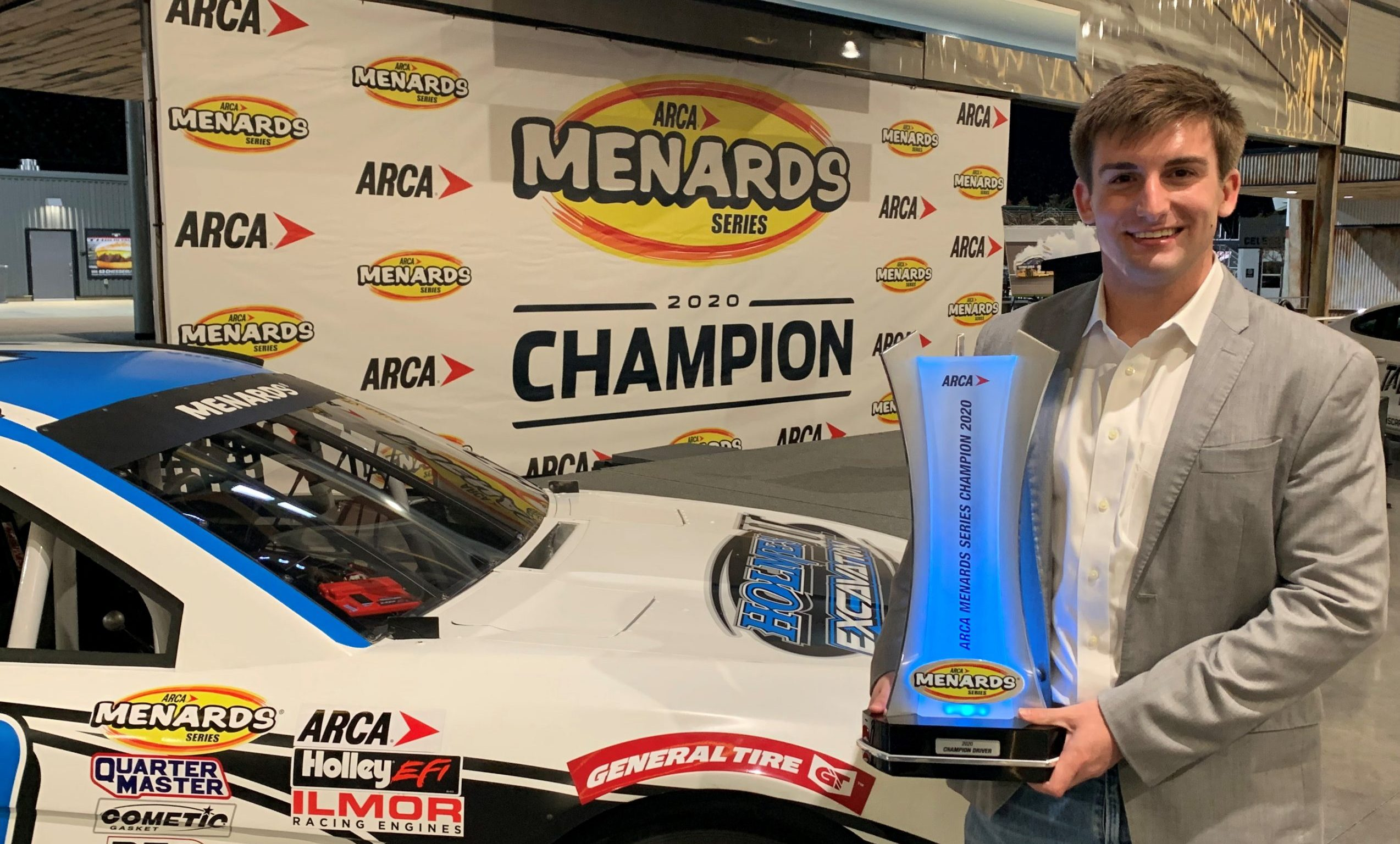Bret Holmes with the 2020 ARCA Menards Series Championship Trophy